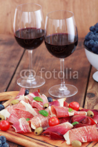 Fototapety sliced prosciutto with red wine and olives