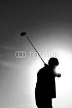 Fototapety Silhouette of a Man Swinging a Golf Club