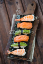 Naklejki Sushi set on a rustic wooden background, studio shot