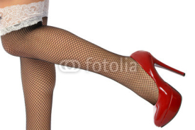Obrazy i plakaty The sensual legs in fishnet stockings
