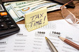 Fototapety Tax time concept with 1040 tax document and money