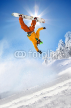 Fototapety Snowboarder jumping against blue sky