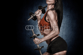 Obrazy i plakaty Athletic young woman doing workout with weights on dark backgrou