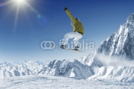 Naklejki Jumping Snowboarder in alpine mountains