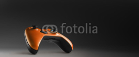 Obrazy i plakaty Video game controller isolated on darkness background