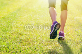 Obrazy i plakaty Woman running outdoors in morning