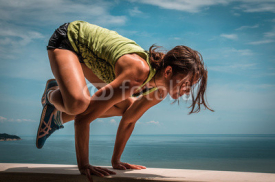 Fototapety Young woman doing pose arm balance