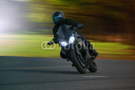 Naklejki young man riding big bike motorcycle on asphalt high way against