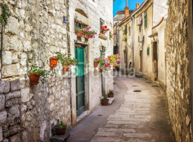 Fototapety Narrow old street and yard in Sibenik city, Croatia, medieval zone