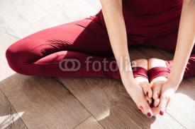Fototapety Hands and legs of young woman doing yoga barefoot