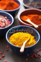 Naklejki spices in bowls: curry, pink and black pepper, paprika powder