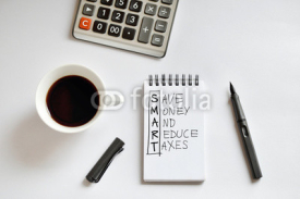 Fototapety Coffee cup, spiral notebook, calculator, and pen on white backgr