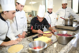 Naklejki Students with teacher in pastry training course