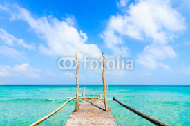 Naklejki Wooden pier leading to sea on beautiful beach at Nam Du Island