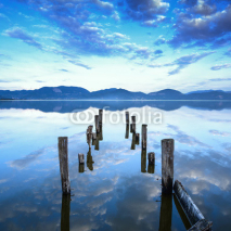 Obrazy i plakaty Wooden pier or jetty remains on a lake sunset. Tuscany, Italy