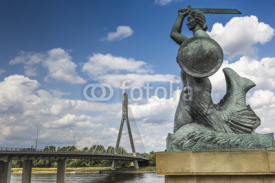 Obrazy i plakaty The Warsaw Mermaid called Syrenka on the Vistula River bank in W
