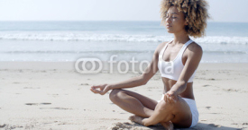 Fototapety Woman Meditating On Beach In Lotus Position