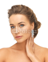 Fototapety woman wearing shiny diamond earrings