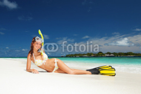 Naklejki Cute woman with snorkeling equipment relaxing on the tropical be