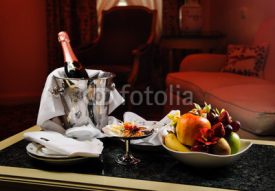 Naklejki Romantic evening with bottle of champagne, sweets and fruits