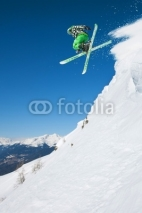 Fototapety Jumping skier in mountains