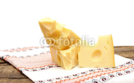 Fototapety piece of cheese on a wooden  table