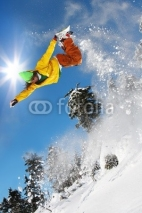 Naklejki Snowboarder jumping against blue sky
