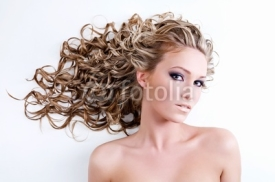 Naklejki Beautiful young woman with long curly hair