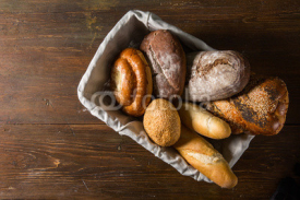 Naklejki Photo of the assorted bread in wooden basket