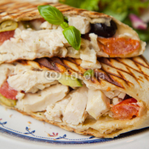 Fototapety Wrap tortilla chicken olives basil salad tomato