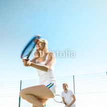 Fototapety Young couple playing tennis