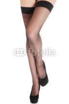 Obrazy i plakaty Beautiful long woman's legs in stockings and black high heels.