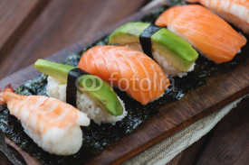 Naklejki Sushi with salmon, shrimp and avocado, close-up