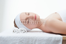 Fototapety Young beautiful woman in spa relaxing on massage table