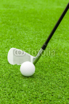 Fototapety golf ball on tee in front of driver on green course