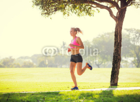 Obrazy i plakaty Young woman jogging running outdoors