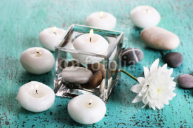Naklejki Decorative vase with candles, water and stones