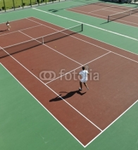 Obrazy i plakaty happy young couple play tennis game outdoor