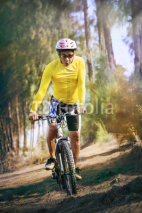 Obrazy i plakaty young man riding mountain bike mtb in jungle track use for sport