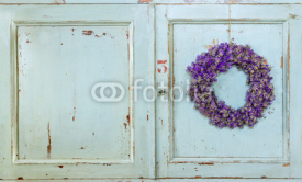 Fototapety Lavender flower wreath hanging on an old door