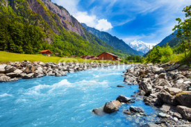 Fototapety Swiss landscape with river stream and houses