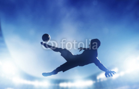 Obrazy i plakaty Football, soccer match. A player shooting on goal