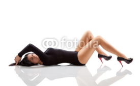 Naklejki Woman with a stunning body lying on floor