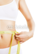 Naklejki close-up photo of sporty woman body with tapemeasure