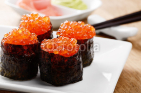 Fototapety Mixed sushi set on a white plate