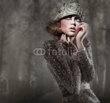 Fototapety beautiful young lady in a mysterious gray forest