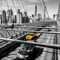 Obrazy i plakaty Taxi cab crossing the Brooklyn Bridge in New York