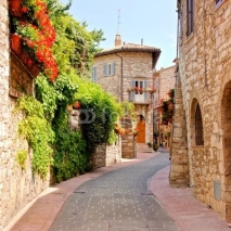 Naklejki Flower lined street in the town of Assisi, Italy