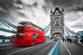 Fototapety Red bus in motion on Tower Bridge in London, the UK