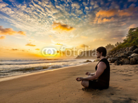 Fototapety Young fit man do yoga meditation on tropical beach